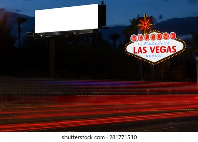 Welcome to fabulous Las Vegas neon sign and blank billboard at night