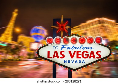 Welcome to fabulous Las Vegas neon sign with Las Vegas strip road background