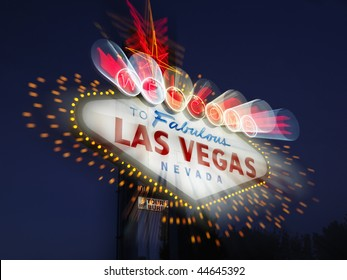 Welcome to Fabulous Las Vegas Nevada sign with motion zoom blur at night. Horizontally framed shot.
