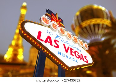 Welcome to Fabulous Las Vegas Sign With Vegas Strip Blurred in Background