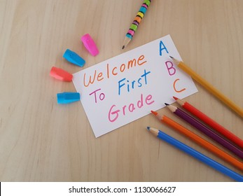 Welcome to first grade sign, Colored pencils and erasers, Back to school, Welcome students, First grade teacher