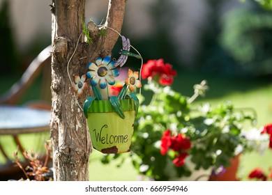 Welcome flower pot in the garden