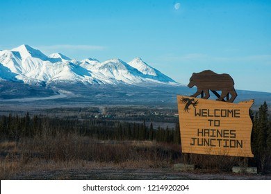 Welcome to Haines Junction Sign with the Kluane Mountaines and the community of Haines Junction in the Background