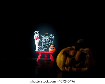 Welcome halloween party notice board on black background, blurred image pumpkin front Halloween party,