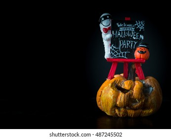 Welcome halloween party notice board on black background, pumpkin front Halloween party,