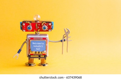 Welcome to industry 4.0 concept. IT specialist steampunk machinery robot, smiley red head, blue monitor body, pliers. New economic future message on blue display. Yellow background copy space.