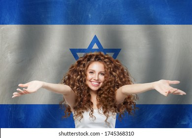 Welcome in Israel! Woman against Israeli flag. Travel and study in Israel