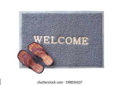 welcome mat with brown sandals on white background