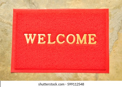welcome mat in front of a door for entrancing into shop