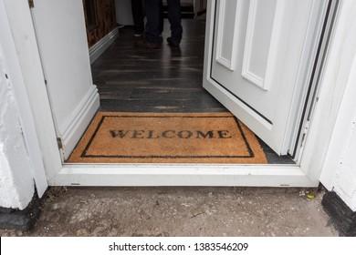 Welcome Mat positioned in an open doorway