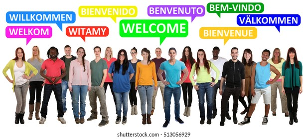 Welcome multi ethnic group of smiling young people saying refugees in different languages