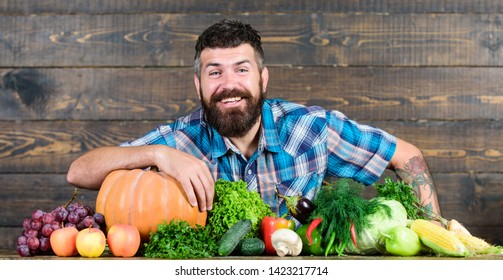 Welcome to my farm. Farmer with homegrown vegetables. Vegetables organic harvest. Farmer rustic style guy. Natural foods. Vegetarian lifestyle concept.