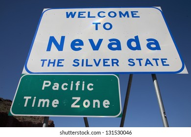 Welcome to Nevada sign with Pacific Time Zone sign