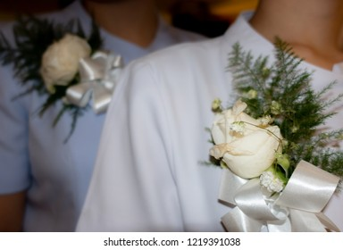 Welcome new team to the meeting,White roses bouquet with ribbon on white uniform for the attendees of the prestigious ceremony,New job,New nurse,Young staff,Good chance,
