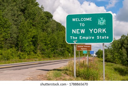 The Welcome to New York state line sign on US Route 62 in Chautauqua County, New York, USA on a sunny summer day