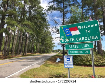 Welcome to North Carolina sign along a beautiful country road.