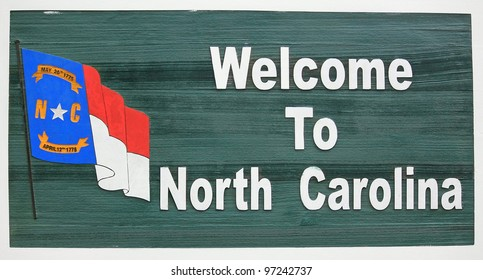 """""""Welcome to North Carolina"""" sign at the Travel and Tourism Welcome Center on the Tennessee and NC border."""
