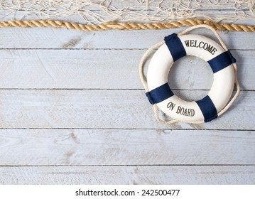 Welcome on Board - lifebuoy on wooden background and copy space for individual text