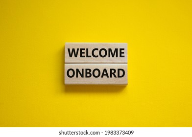Welcome onboard symbol. Wooden blocks with words 'Welcome onboard' on beautiful yellow background. Business and welcome onboard concept. Copy space.