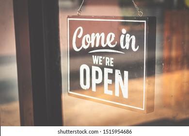 Welcome open sign on door .vintage tone.
