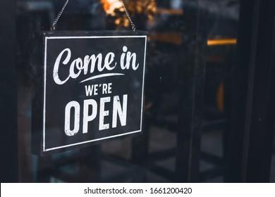 Welcome open sign on shop door .vintage tone stye. - Shutterstock ID 1661200420