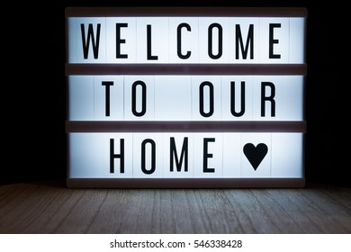 'Welcome to our new home' text in lightbox