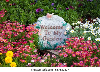Welcome sign among beautiful flowers