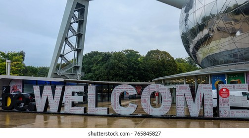Welcome sign in front of Atomium structure, Brussels, September 2017
