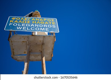 Welcome sign at the harbor of Folegandros with a deep blue sky, Greece 2013.