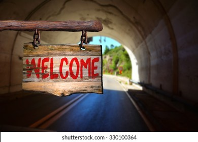 Welcome sign on old wood with blurred background