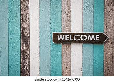 welcome sign on retro wooden background