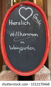 Welcome sign outside wine garden in famous tourist destination of Rudesheim on the Rhine River, Germany, August 2019