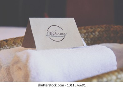 Welcome sign is placed on the towel in a comfortable and relaxing room.