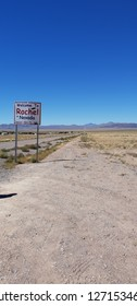 Welcome sign to Rachel Nevada on a desert road