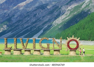 Welcome sign for village of Livigno, near the picturesque lake in valley surrounded by Italian Alps. Ski resort Livigno, Lombardy, Italy