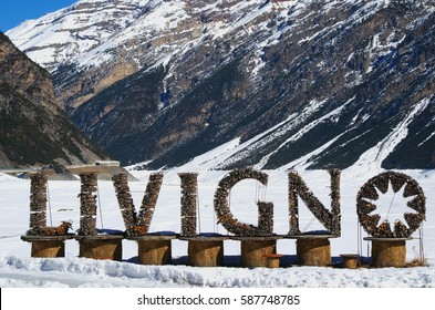 Welcome sign for village of Livigno. Wintry view. Ski resort Livigno, Lombardy, Italy