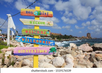Welcome signs in different languages in Willemstad cruise port, Curacao, Caribbean island.
