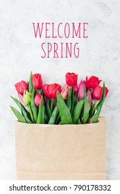 Welcome Spring. Bouquet of tulips  in paper kraft paper bag