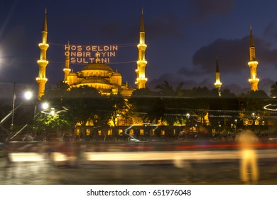 """Welcome to the sultan of eleven months"" lettering hanging on Blue Mosque's mahya in Istanbul,Turkey.Mahya is an enlightenment arrangement during ramadan nights between two minarets."