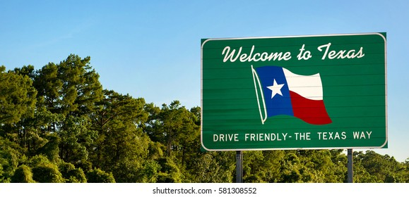 Welcome to Texas sign - panorama view with trees
