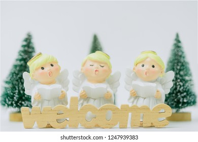 Welcome word and Christmas caroling or Carolers singing.Angel group singing carol song on celebration of christmas day in winter time white background.
