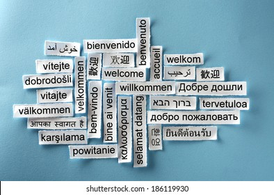 welcome  Word Cloud  printed on  paper on blue
