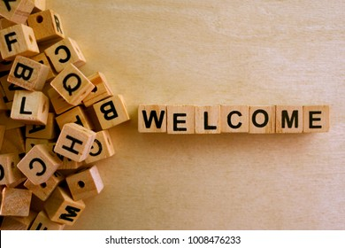 Welcome word cube on wood background ,English language learning concept