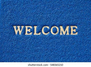 WELCOME word on plastic doormat