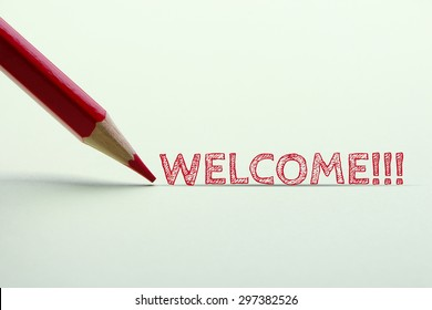 Welcome word is standing on the paper with red pencil aside.