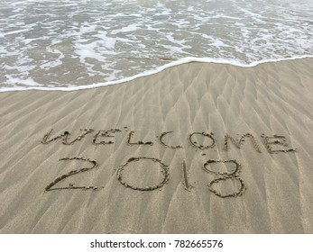 Welcome year 2018 on sand with nice pattern