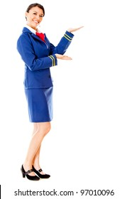 Welcoming air hostess smiling - isolated over a white background