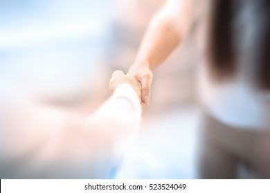 Welcoming business woman giving a handshake