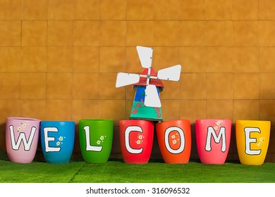 Welcoming and greetings concept with welcome word and sign on colorful hanged tags