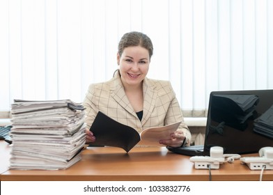 Welcoming receptionist a woman looking at camera with schedule or list